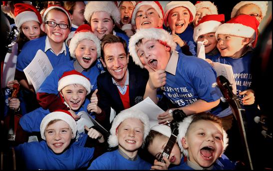 Ryan Tubridy having some fun singing Christmas Carols with children from St. Margaret's National School Choir at the launch of the St. Vincent de Paul Annual Appeal.