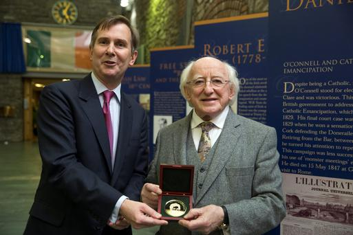 President Michael D Higgins receives a medal from Bar Council chairman David Barniville SC, after speaking at the Daniel O'Connell Memorial Lecture at the Law Library