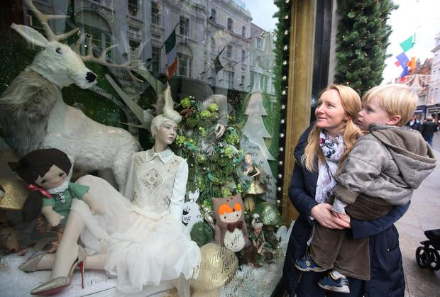 Kathleen Dobson and her son Dylan (2), from Dún Laoghaire, look at a Christmas window in Brown Thomas on Grafton Street, Dublin