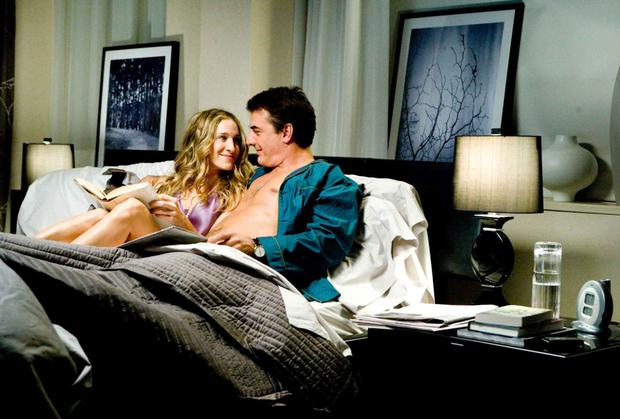 CUDDLING UP WITH A GOOD BOOK: Mr Big and Carrie in a scene from 'Sex and the City'