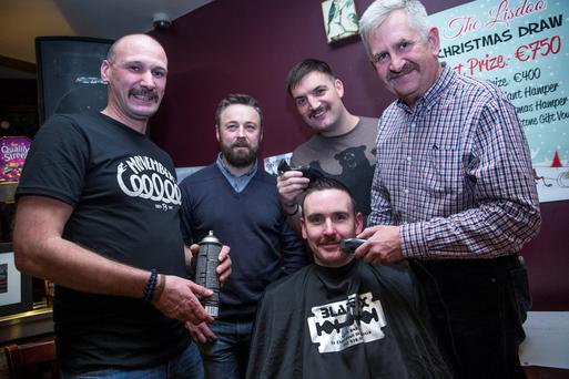 L-R: Garda Damien Fanning, Pat Rogers of Blade FX, Sgt Mark McNulty, Garda Declan Whelan and Garda Kevin Cleary (in front) take part in Movember in memory of Garda Tony Golden who was shot dead earlier this year