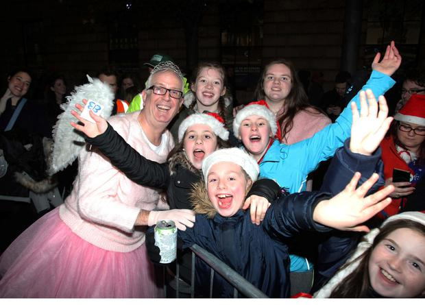 Rory Cowan from 'Mrs Brown's Boys poses with audience members at the annual Christmas tree lighting