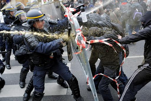 Police fight with activists during a protest at the Place de la Republique in Paris