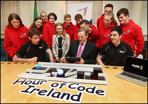 Taoiseach Enda Kenny with Niall McCormick (left in black) of Colmac Robotics with Lauren Boyle (11, centre) and members of the Digital Youth Council of Ireland playing Sphero at the launch of Ireland's 2015 Hour of Code