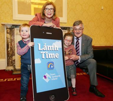 Education Minister Jan O'Sullivan with James Heneghan (6) from Donadea, Co Kildare, Julianne Haide (6) from Blessington, Co Wicklow, and Pat Clarke, CEO of DSI, at the launch of the Lámh app