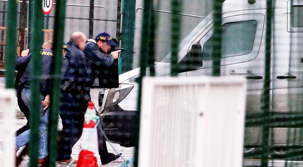 WEAPONS DRAWN: Members of the elite ERU approach a GSLS security cash-in-transit van in the cargo area of Dublin Airport in the midst of a tiger kidnapping last week