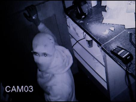 These images taken from the CCTV footage show the masked thug look straight at the camera as he begins his thievery