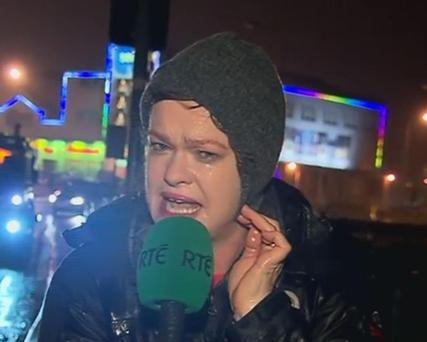 Teresa Mannion reporting on RTE news during storm Desmond