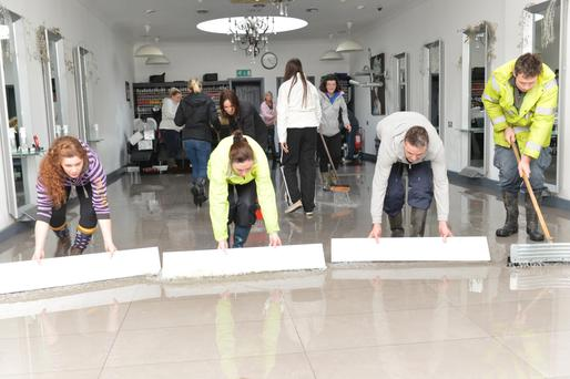 Volunteers in Bandon attempt to clear up after the town was flooded