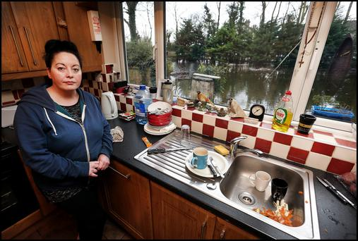 Una Stroud from Athlone town surveys the damage to her property from her kitchen looking out into her back garden