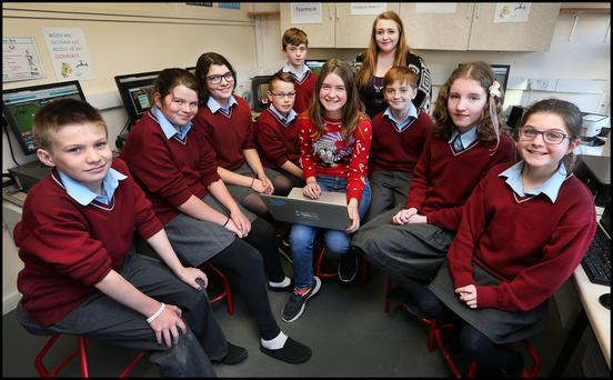 Taking part in the 'Hour of Code' at Scoil Mobhi in Glasnevin were from left, Cal McLaughlinn, Méabh Keegan, Yana Brennan, Eoin Gaughran, Evan Keeley Burke, coding mentor Niamh Scanlon (13), teacher Catrina Carrigan, Tim Cleary, Rachel Ní Mhathéna and Rachel Ní Oisín
