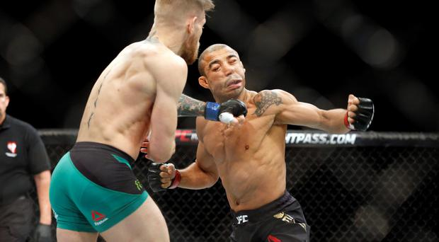 Conor McGregor knocks out Jose Aldo during a featherweight championship mixed martial arts bout at UFC 194 in Las Vegas