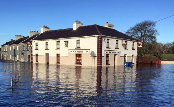 Hughes Bar at Ballinamore Bridge, Ballinasloe, Co Galway, during the floods. Photo: Hany Marzouk