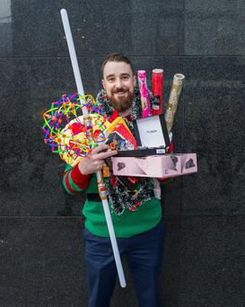 John Brennan with €50 worth of gifts on Henry Street. Photo: www.doug.ie