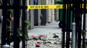 Debris scattered on the pavement after the balcony collapse. Photo: REUTERS