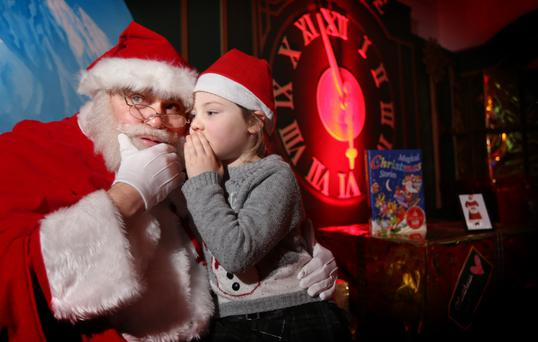 SHHH: Santa Claus, formerly of the now-closed Clerys but now in the CHQ building, with Aoibh Brannick from Limerick. Photo: Gerry Mooney