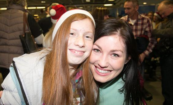 Andrea Keogh from Thomastown with Nastassia Drob (12) from Belarus at Dublin Airport yesterday. Photo: Gareth Chaney, Collins