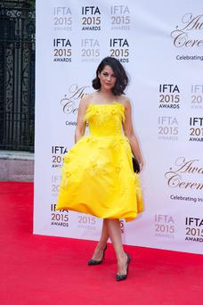 Cork actress Sarah Greene in the yellow Helen Cody dress at the 2015 IFTAs.