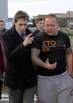 Minister Simon Harris with Gary Sheridan, a tattoo artist in Ballinasloe, whose premises were flooded. Photo: Gerry Strong