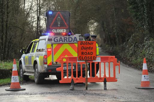 Gardaí on the Kilworth to Ballyduff Road, Co Cork, near the scene of the fatal road traffic collision. Photo: Daragh McSweeney/Provision