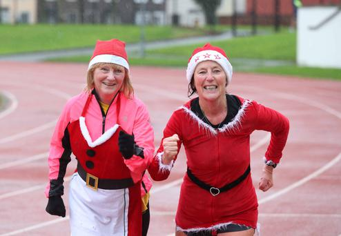Rosemary Phipps and Susan Walsh running in the GOAL Mile Run in Irishtown Stadium in Dublin. Photo: Sasko Lazarov