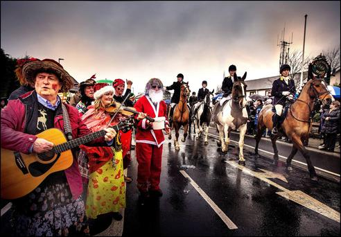 COLOUR AND CULTURE: The Wren Boys of Ashbourne wave off the Ward Union Hunt. Photo: David Conachy
