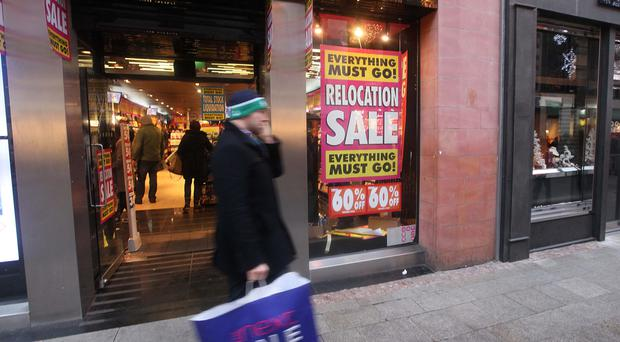 A shopper on Grafton Street in Dublin. Photo: Collins