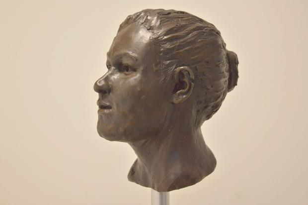 Cranial reconstruction by Elizabeth Black – the woman's genes tell us she had black hair and brown eyes. Photo: Barrie Hartwell