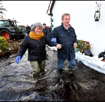 Taoiseach Enda Kenny visits the home of Gertie Dunning in Carrickobreen in Athlone during the flooding. Photo: Steve Humphreys