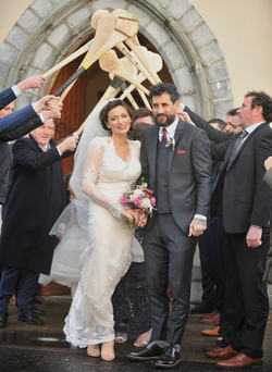 Today FM presenter Louise Duffy and Kerry footballer Paul Galvin leave St Tiernan's Church in Crossmolina, Co Mayo, after their wedding Photo: Conor McKeown