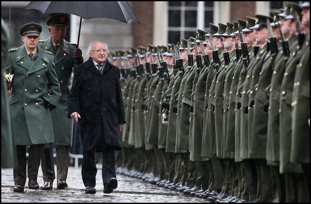 CEREMONY: President Michael D Higgins at the flag raising ceremony at the opening of the State Commemorative Programme for 2016 at Dublin Castle. Photo: Steve Humphreys