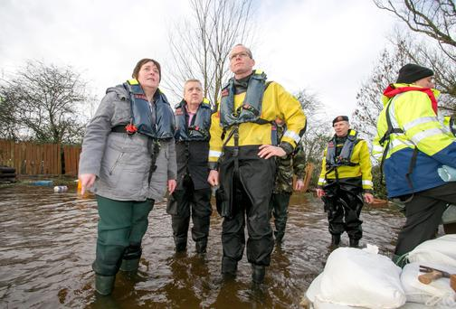 Flooding victim Geraldine Quinlivan and TD Pat Breen in Clonlara, Co Clare, yesterday. Photo: Arthur Ellis