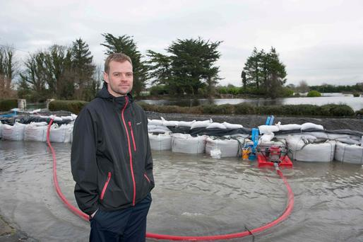 Paul Moran finally lost the fight against flood waters at his parents-in-law's cottage in Kinvara, Co Galway. Photos: Andrew Downes