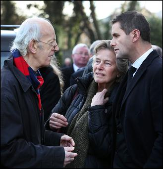 Actor Tom Hickey, star of 'The Riordans' consoles Wesley Burrowes' widow Helena and son Kim at the funeral in Bray