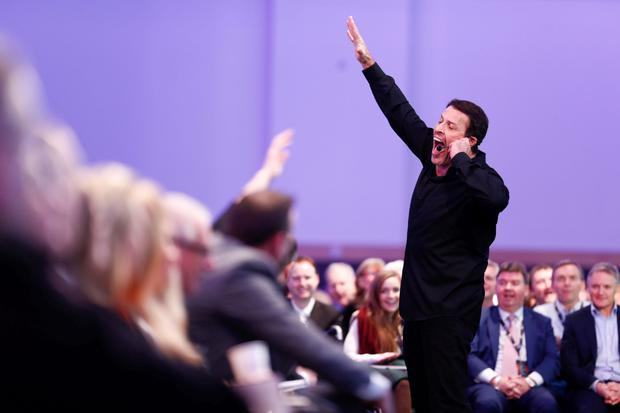 US motivational guru Tony Robbins in action at the Pendulum Summit in Dublin's National Convention Centre yesterday