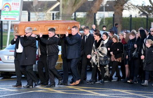 The remains of Claire Hewitt are brought to St Ciaran's Church, Hartstown, across the road from the spot where she was knocked down. Photo: Mark Condren