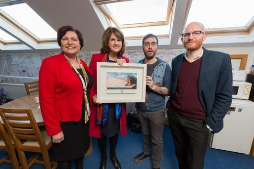 Tánaiste Joan Burton with Paul Young (right) and Tomm Moore of Cartoon Saloon and TD Ann Phelan during a visit to the Kilkenny-based Oscar-nominated animation company yesterday. Photo: Dylan Vaughan
