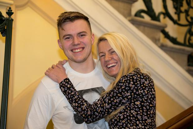 Jamie Mooney and his mother Sabrina at the launch of Family Carers Ireland yesterday. Photo: Mark Condren