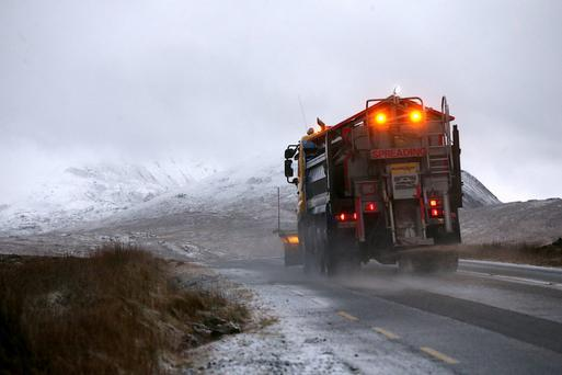 A snow plough grits the road near Glenveagh National Park, Co Donegal