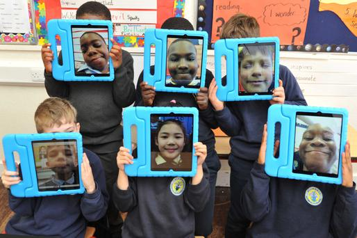 Pupils of Our Lady of the Wayside National School in Bluebell, Dublin, pose with iPads. Photo: Clodagh Kilcoyne