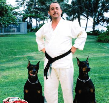 Higgins from Magnum P.I. with his dobermans