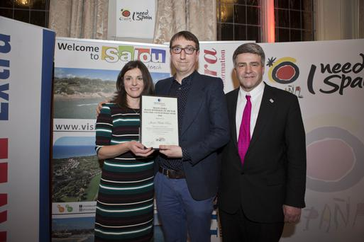 WINNER: Newcomer/Young journalist winner Jamie Blake Knox of the Sunday Independent, centre, is presented with his award by Charlotte Brenner of Falcon Holidays, at the Travel Extra awards in Dublin last week. Right is Eoghan Corry, editor of Travel Extra