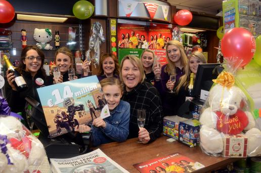 Lorraine O'Connor, the owner of Carey's shop in Belmullet, where the winning €13.7m Lotto ticket was sold on Saturday, with her daughter Molly O'Connor and staff members. Photo: Paul Mealey