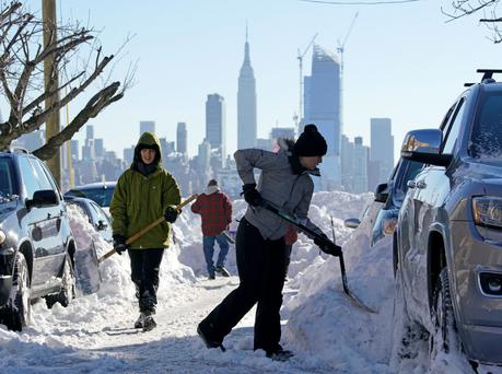 Residents dig their car out of the snow in Union City, New Jersey, after blizzards brought the second biggest snowfall in the history of New York. Photo: Reuters
