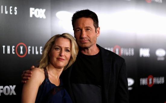 Cast members Gillian Anderson and David Duchovny pose at a premiere for