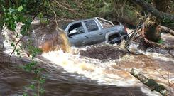 The 4x4 from which a farmer was rescued in the River Roe at Dungiven, Co Derry. Photo: Margaret McLoughlin.
