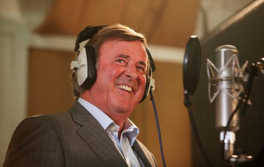 Terry Wogan, left, behind the microphone where he was at his most comfortable. Photo: PA