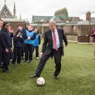 Taoiseach Enda Kenny plays football while visiting Mount Carmel Secondary School on King's Inn Street, Dublin Photo: Mark Condren
