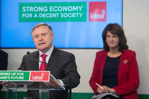 Howlin speaks as Tánaiste Joan Burton listens at the launch of Labour's economic plan yesterday. Photo: Gareth Chaney