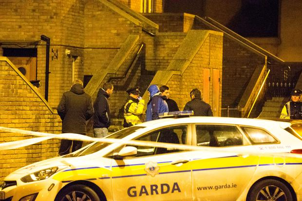 Gardaí swarm around the scene on Poplar Row in north inner city Dublin where Eddie Hutch was shot